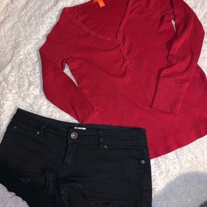Black shorts and red long sleeve top